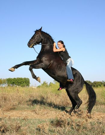 riding young woman Stock Photo