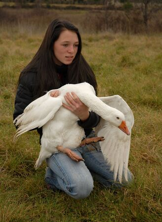 teenager and goose photo