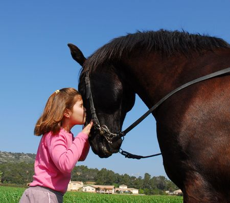 woman and horse: girl and stallion Stock Photo