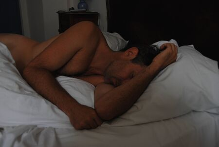 nude man sleeping in a bed in a hotel Stock Photo - 1719862