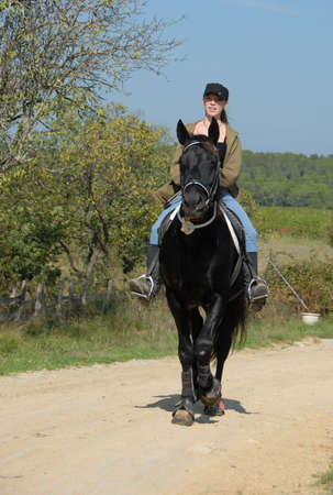 riding young woman and her best friend black stallion  photo
