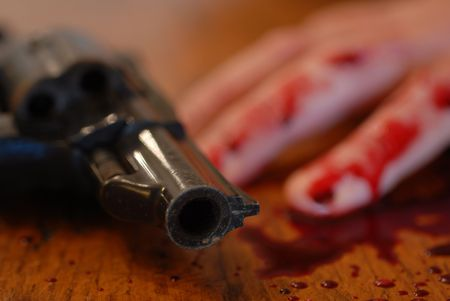 teenager who committed suicide from a bullet of revolver... photo