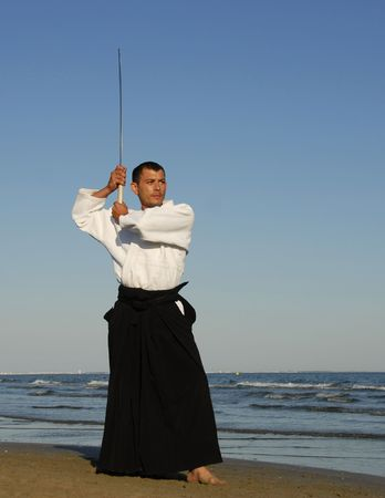 aikido: a young man are training in Aikido on the beach Stock Photo
