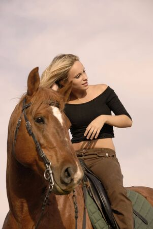 light brown horse: riding girl and her brown stallion. focus on the teen