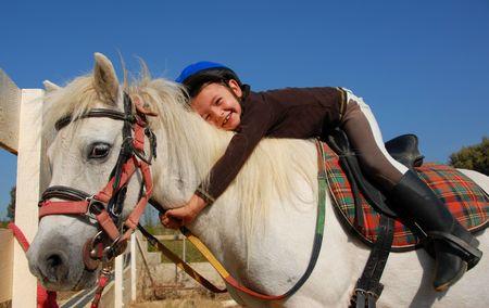 pony girl: little girl and her best friend white shetland pony