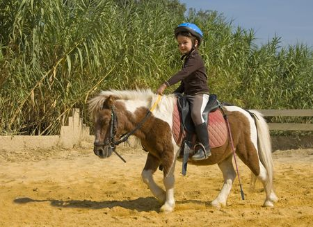 miniature people: riding child Stock Photo