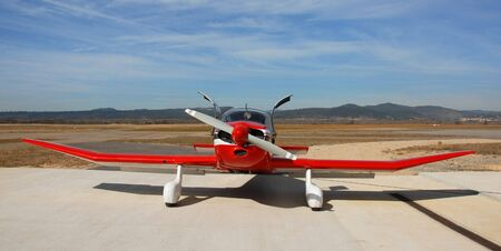 dr: private red plane Robin DR 250 on an airport in the south in France Stock Photo