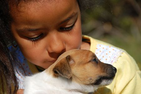 metis: little girl and her very young puppy jack russel terrier
