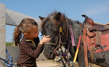 little girl and her best friend pony shetland Stock Photo