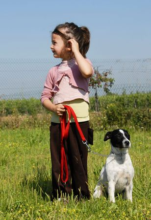 little girl and her purebred jack russel terrier photo