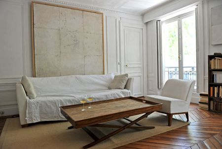 modern living room with two glasses of white vine