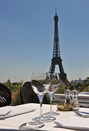viewpoints: Luxury restaurant with Eiffel Tower behind in a blue sky