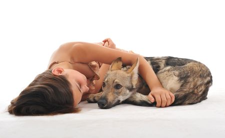 young girl and her puppy slovakia wolf sleeping together photo