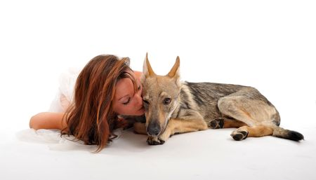 young woman and her puppy slovakia wolf sleeping together photo