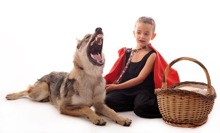 riding wolf: Little Red Riding Hood and angry wolf