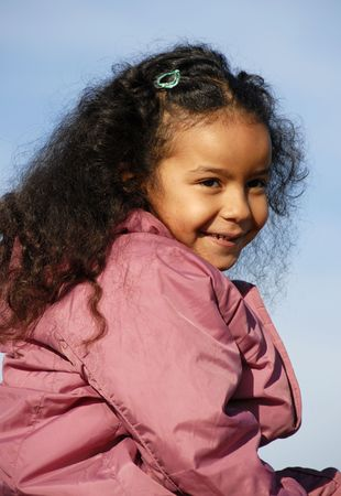 afro girl: portrait of a little afro girl in winter