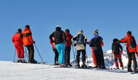 skiers: skiers on  a ski slope in the french alps.  Stock Photo