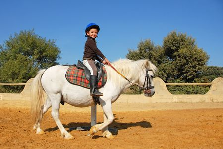 pony: young girl and her best friend white shetland pony