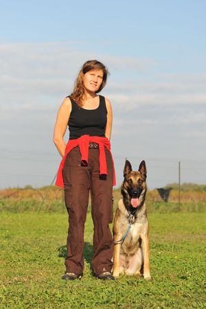 young woman and her purebred belgian sheepdog malinois photo