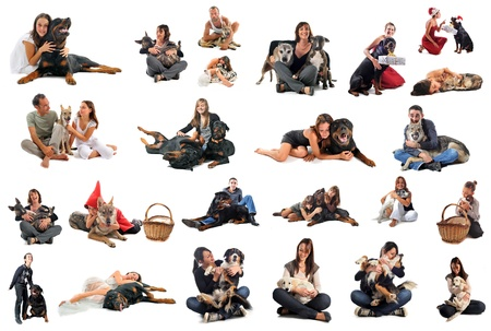 people with purebred dogs and puppies in front of white background photo