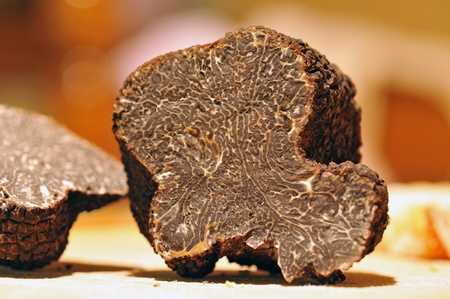 black truffles (tuber melanosporum) on a table