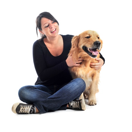 purebred golden retriever and woman in front of a white background