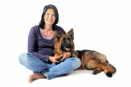 portrait of a  purebred german shepherd and chinese girl in front of white background photo