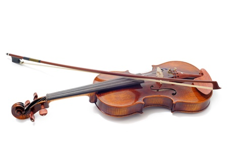 sheet music background: beautiful violin isolated on a white background