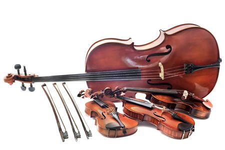 violines: violines hermosos aislados en un fondo blanco y el violonchelo Foto de archivo