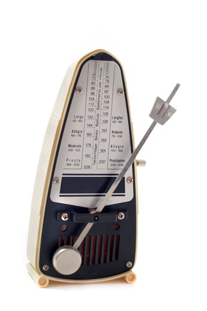 ivory metronome isolated on a white background photo