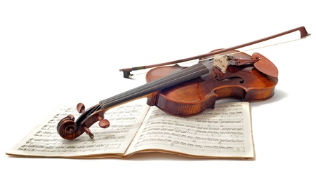 violin player: beautiful violin and sheet music isolated on a white background Stock Photo