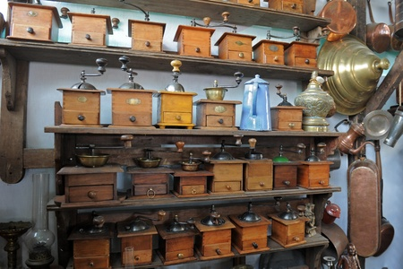 antiquary: shelves of Coffee Grinder in a shop of antiquarian