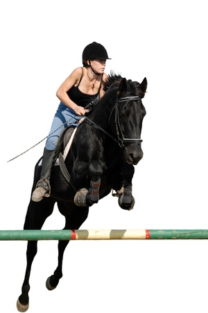 young teenager and her black horse in training of jumping competition