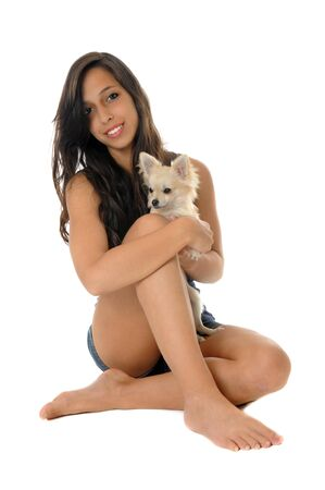 long hair chihuahua: portrait of a young woman and white chihuahuas in front of white background