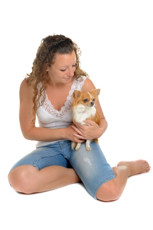 young woman sitting: woman and  her chihuahua in front of white background Stock Photo