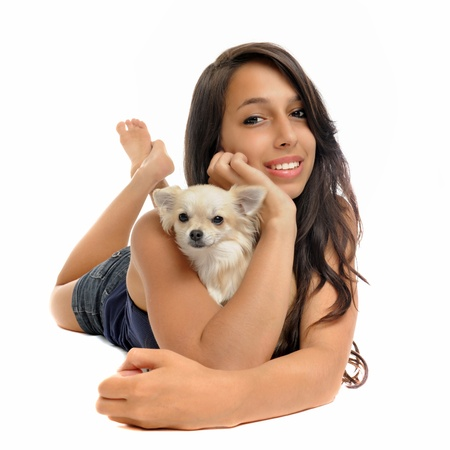 portrait of a young woman and white chihuahua in front of white background photo