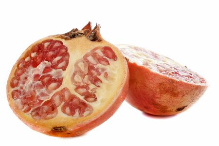 punica granatum: pomegranate or punica fruit in front of white background