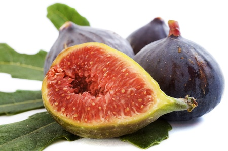 purple fig: black figs and leaf in front of white background