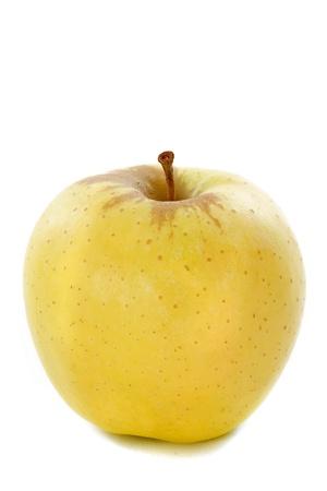 golden apple: golden apple in front of white background Stock Photo