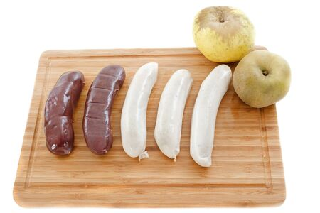 russet: black pudding sausages and white sausage, boudin, on a cutting board