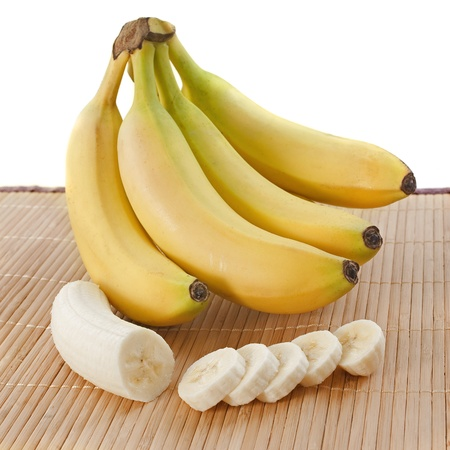 banana: bunch of bananas  and slices on a wooden set
