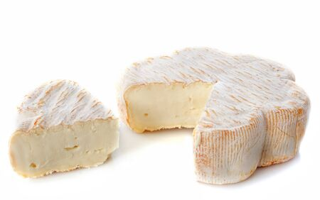 pasteurized: french cheese with pasteurized cows milk in front of white background
