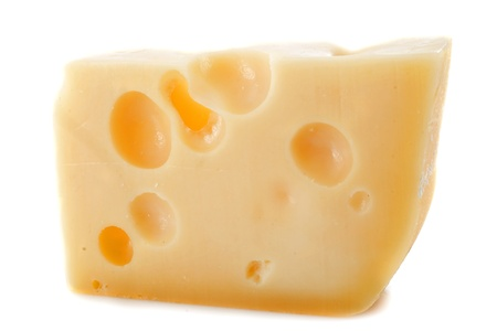 gruyere: Piece of cheese gruyere in front of white background