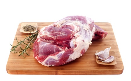 raw shoulder of lamb on a cutting board Stock Photo