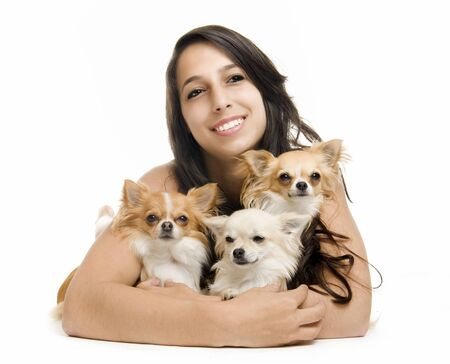 brune: portrait of a woman andthree chihuahuas in front of white background