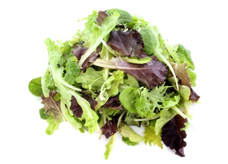 mesclun salad in front of white background