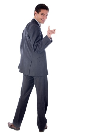 looking back: young business man inform  in front of white background