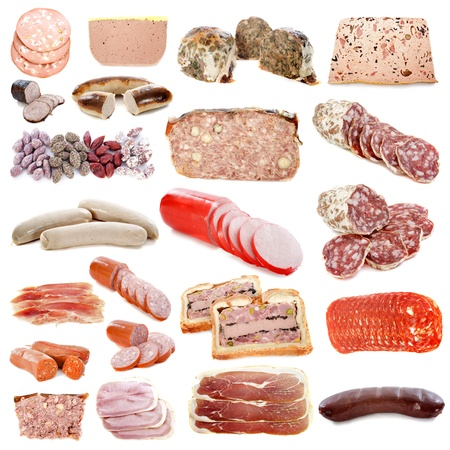 meats: cooked meats in front of white background