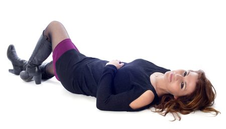 lying down: beautiful  woman laid down in front of white background