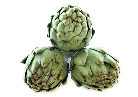 three artichokes in front of white background Stock Photo - 17333380